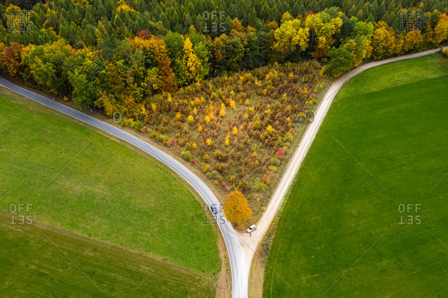 Aerial view of an autumn landscape with roads forming a triangle, Hessia, Germany.