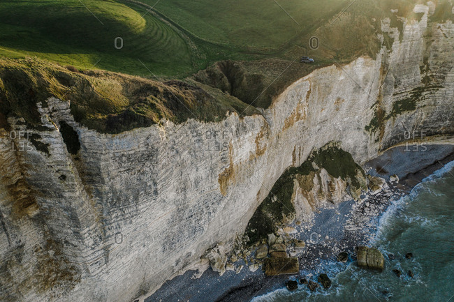 Aerial view of car on cliff in Etretat, Normandy, France.