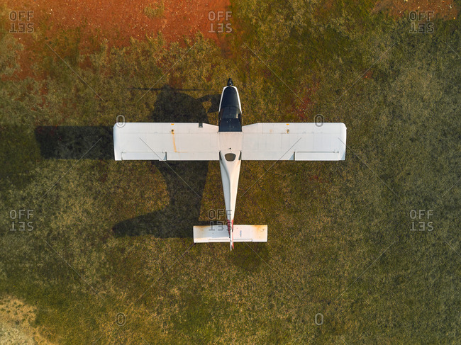 Aerial view of a two-seater ultralight airplane at ground in the airfield for maintenance in Senago, Lombardy, Italy.