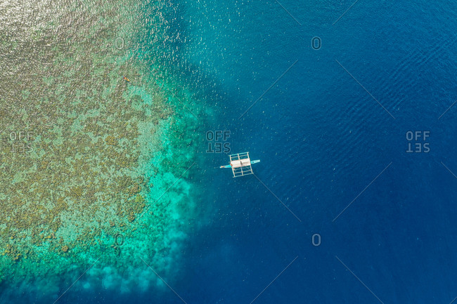 Aerial view of  Reef with outrigger boats in front of CYC Beach, Coron, Palawan, Philippines.