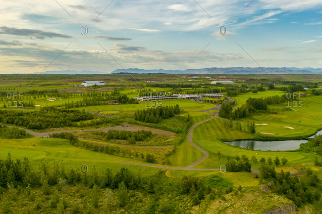 Aerial view of golf course and Icelandair hotel Hamar with mountain view in Borgarnes, Iceland.