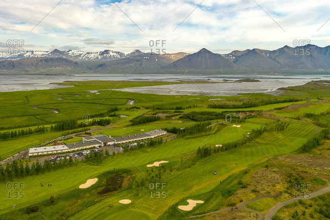 Aerial view of golf course and Icelandair hotel Hamar with mountain view in Borgarnes, Iceland