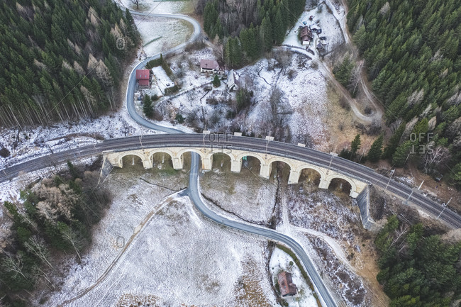 Aerial view of the Semmering railway cover by snow, in Adlitzgraben, Austria