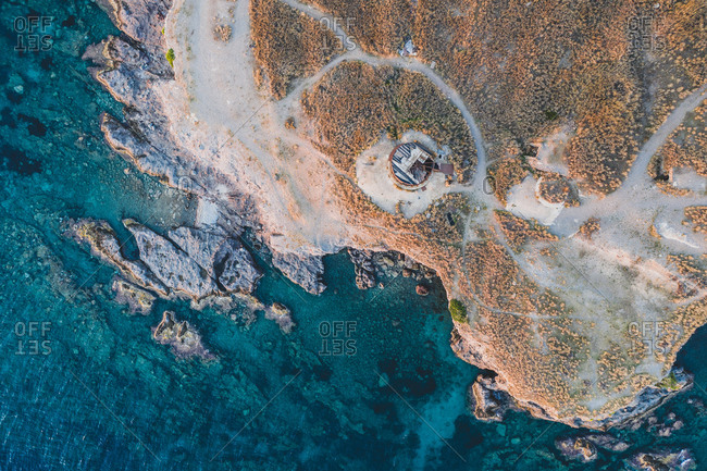 Aerial view of the derelict lighthouse in the sunset, in Peloponnese, Greece