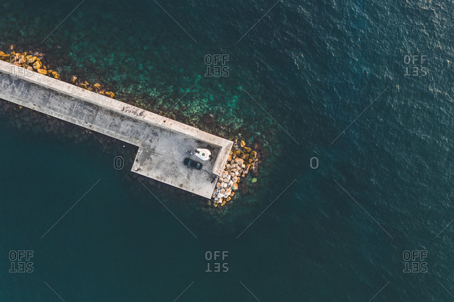 Aerial view of the wharf with a fisherman, in the Marina Alimnos, Athens, Greece