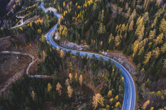 Aerial view of road cross over the autumn forest , in the Mariazell, Styria, Austria