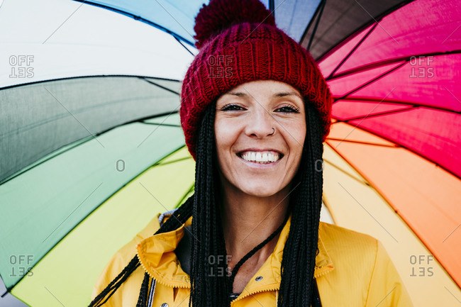 Close-up of smiling woman holding umbrella