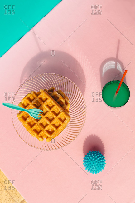 Directly above view of waffle- juice- rubber ball kept on table
