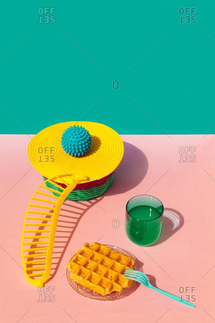 Waffle- juice- banana shape and rubber ball kept on basket