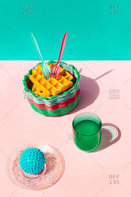 Waffle in basket- juice and rubber ball kept on table