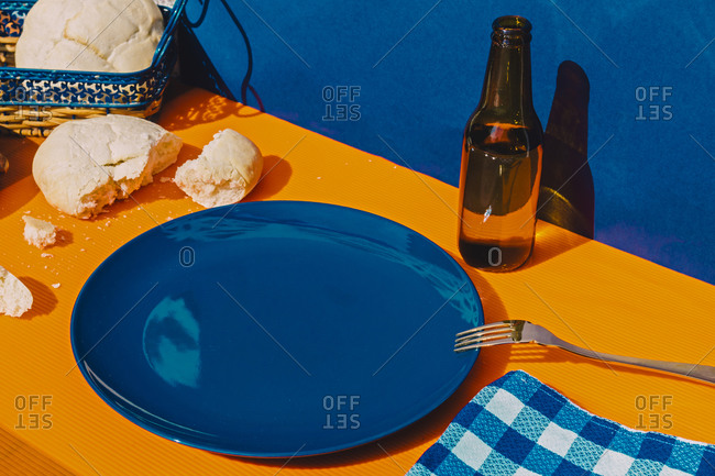 Bread- bottle of beer and empty plate