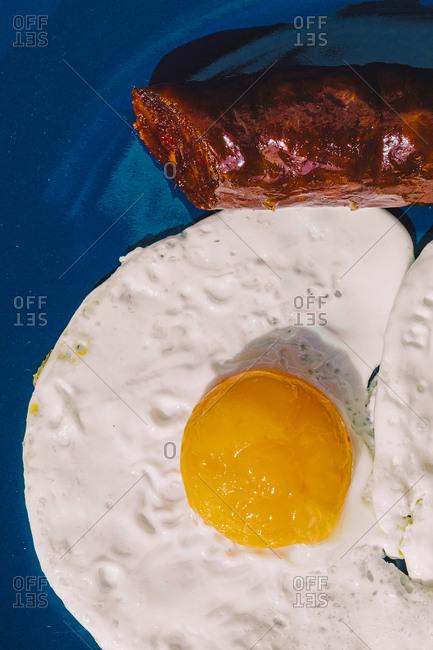 Fried egg with chorizo meal