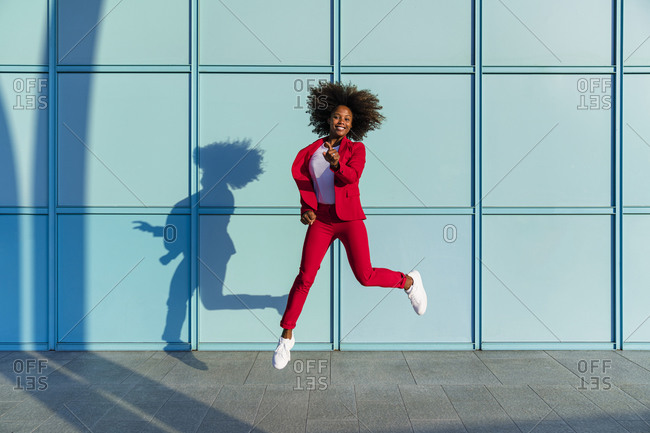 Woman jumping cheerfully on sunny day