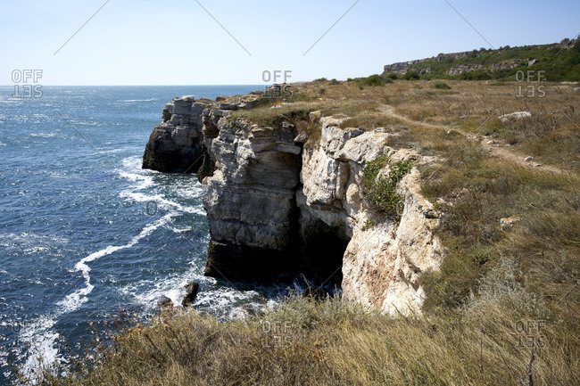 View of the Black sea coast against a clear blue sky. Yailata National Nature and Archaeological Reserve is located 1.5 km southern from the village.