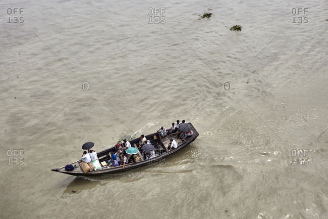 May 13, 2013: River Karnaphuli, Chittagong, Bangladesh;  Karnaphuli (Karnafuli) is the largest and most important river in Chittagong and the Chittagong Hill Tracts. High point view of a boat with passengers, navigating on the river.