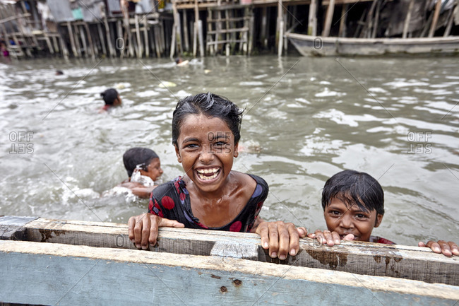 May 14, 2013: Slum area in Barisal, Bangladesh; The slums lack basic infrastructure and services and are in the constant threat of eviction. Because these are usually situated in fragile low lying areas, the urban poor living are highly vulnerable to natural disaster. Water and air pollution from poor waste and traffic management poses serious health risks.