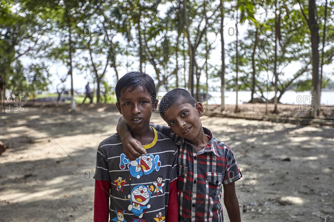 May 14, 2013: Rural Bangladesh; Two boys posing in front of the camera in a rural Bangladesh. In Bangladesh, children face huge challenges from the moment they are born.