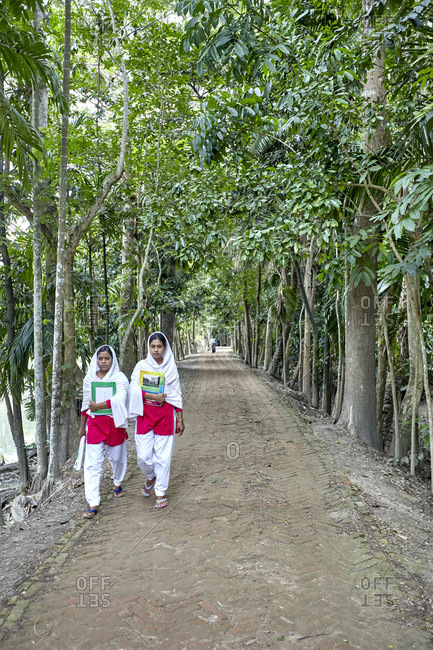 May 14, 2013: Rural Bangladesh; Two young women going to school in rural Bangladesh. The status of women in Bangladesh has been subject to many important changes over the past few centuries.