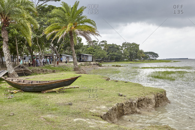 May 14, 2013: East Side of Kirtonkhola River, Barisal, Bangladesh, May 14, 2013; Group of villagers staying on the shore of Kirtonkhola River in Bangladesh