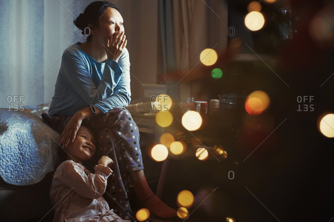 Mother and daughter at home decorated for Christmas holiday