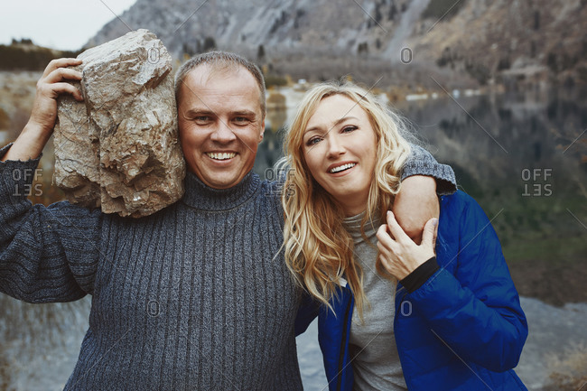 Happy couple being playful and silly while looking into the camera. Real people grimacing