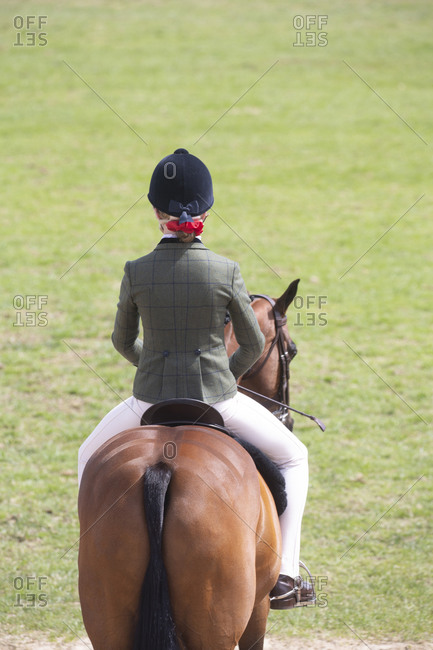 Melbourne, Australia - September 28, 2017: Rear view of young female rider in a horse riding competition at the fair in Melbourne