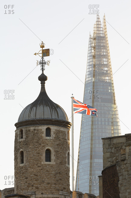 London, United Kingdom - September 11, 2016: Top spire of Tower of London with view the Shard office tower behind it at dusk