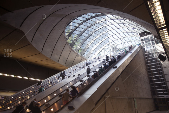 London, United Kingdom - September 13, 2016: People riding the escalator at the Canary Wharf Underground Station