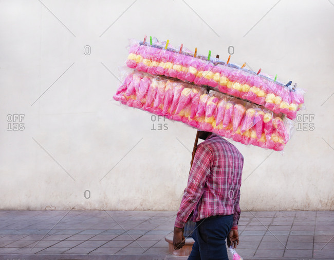 Man selling candy floss at the market in New Delhi, India