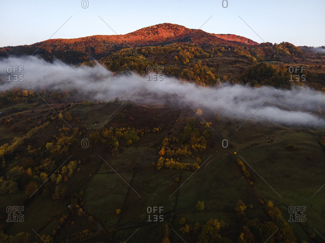 A line of low lying clouds in the mountains at sunrise