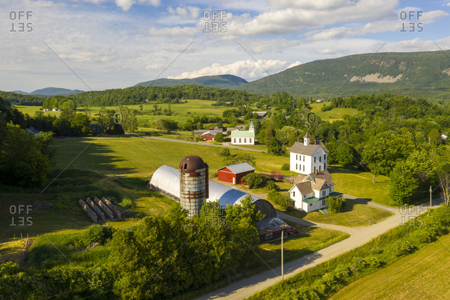 Farmhouses and church in the rural town of New Haven Mills, Vermont