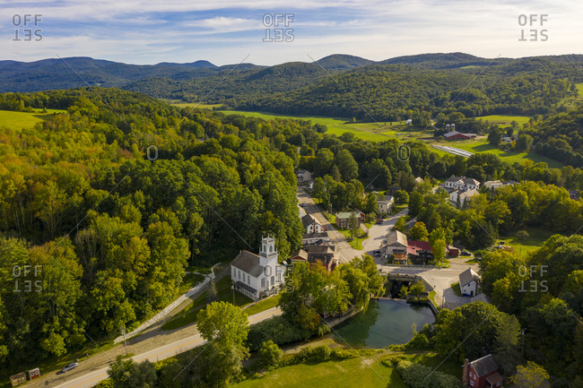 Bird's eye view over rolling green hills and town of Pawlet, Vermont