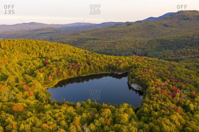 Pleiad Lake surrounded by autumn foliage in rural Hancock, Vermont