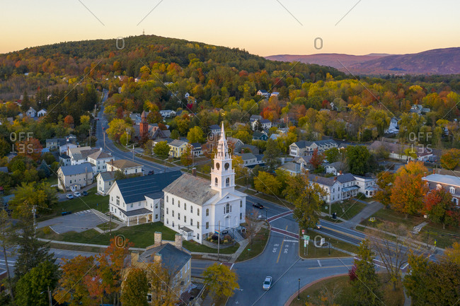 Bird's eye view over buildings and fall foliage in the town of Middlebury, Vermont