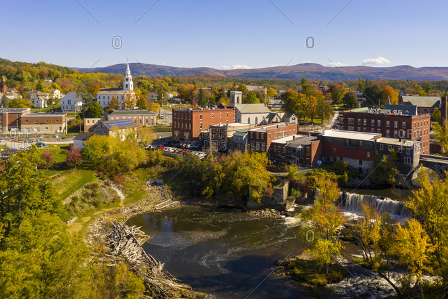 Bird's eye view over buildings and waterfall in the town of Middlebury, Vermont