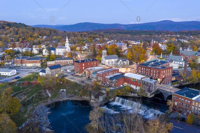 Blue hour over buildings and waterfall in the town of Middlebury, Vermont