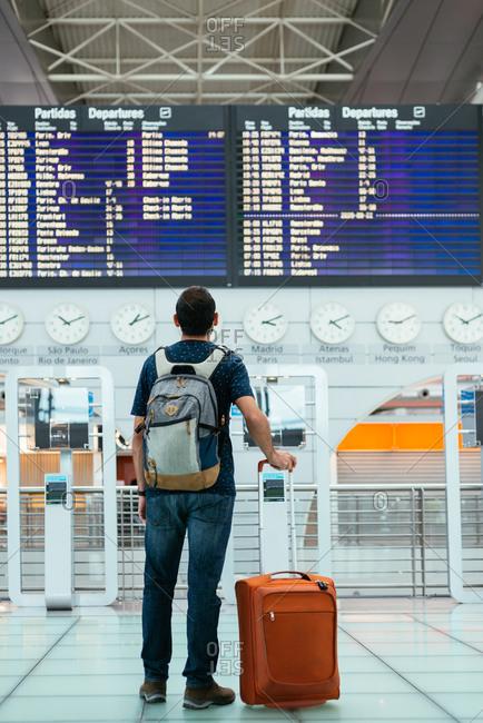 Young man waiting his flight at the airport