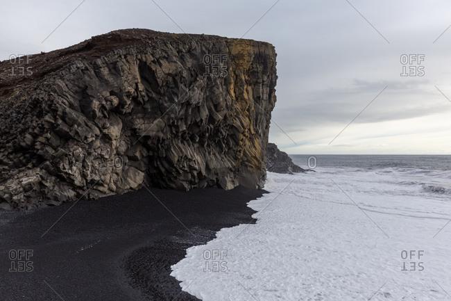 Basalt rock formations on icelandic black-sand beach