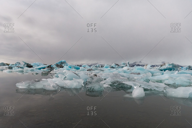 Glacier melting into jokulsarlon, iceland's famed glacial lake
