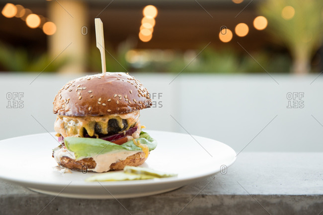 An American cheeseburger served on a plate outdoor