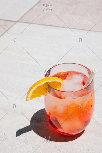 An apiol spritz garnished with lemon