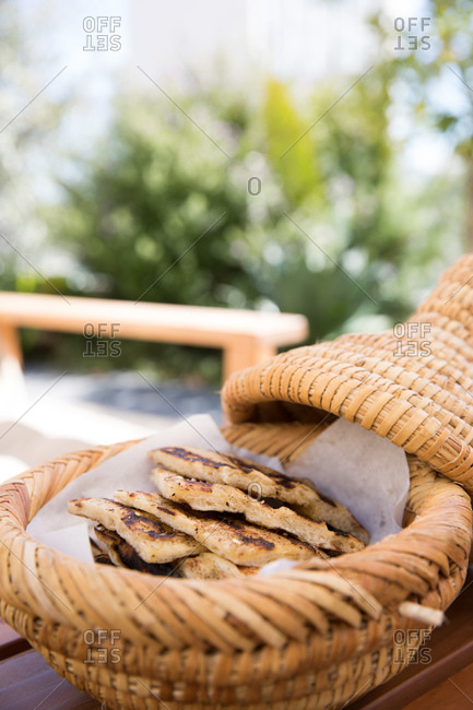 Pita in a wicker basket served outdoors