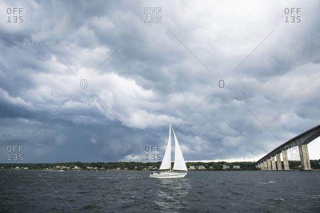 Dark storm encompassing boat on the ocean