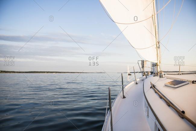 Boat sailing during golden hour summer sunset