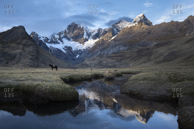 Mountains reflected on the water of Mitucocha lagoon in Huayhuash