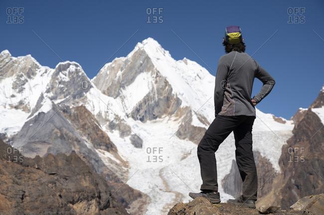 One person watching snowed high summits of cordillera huayhuash