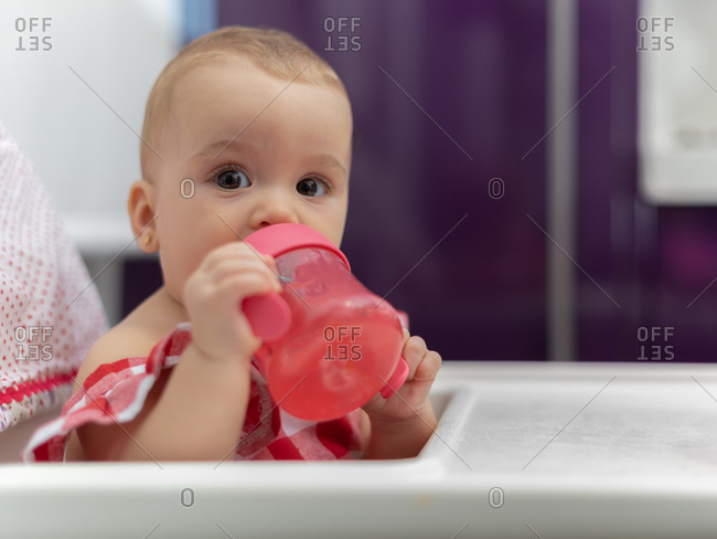 Close-up of a baby drinking water