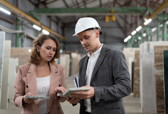 Woman picking marble with warehouse manager