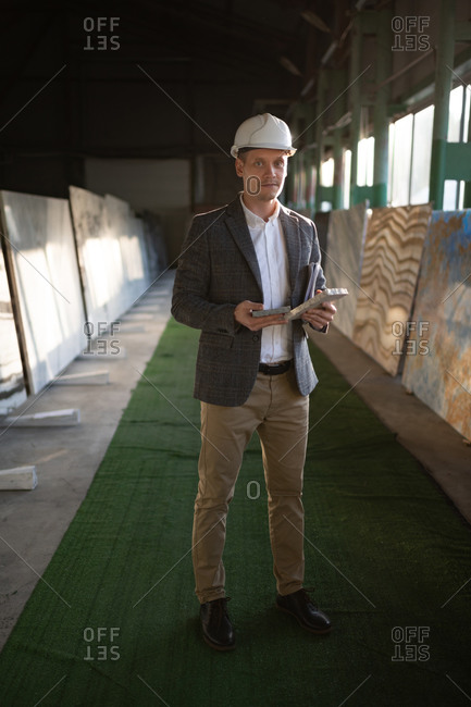 Focused male engineer in stone company storage