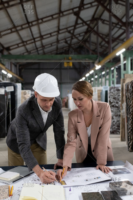 Creative architects working on project in stone manufacture